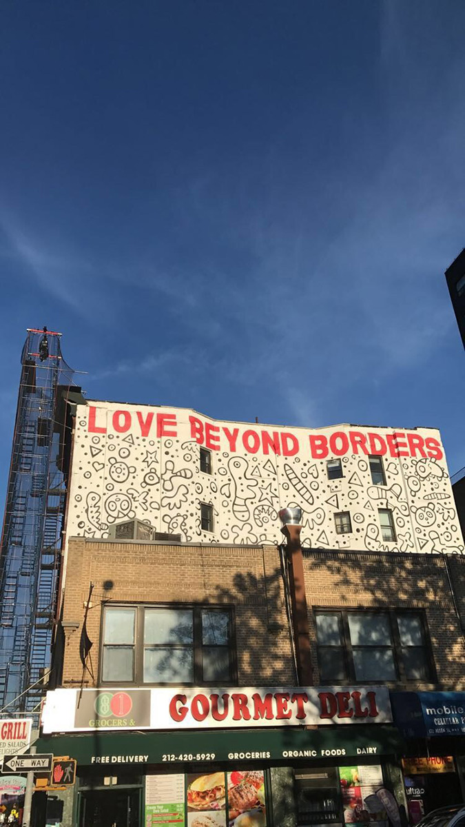 Love Beyond Borders sign atop a business