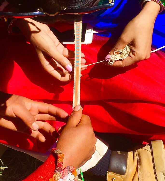 Overhead shot of women weaving