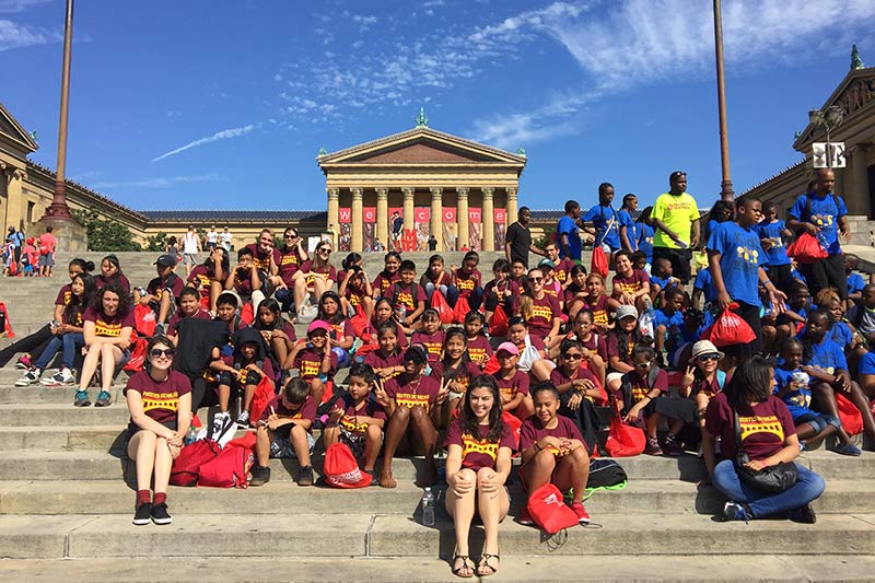 Students sit on art museum steps in Philadelphia