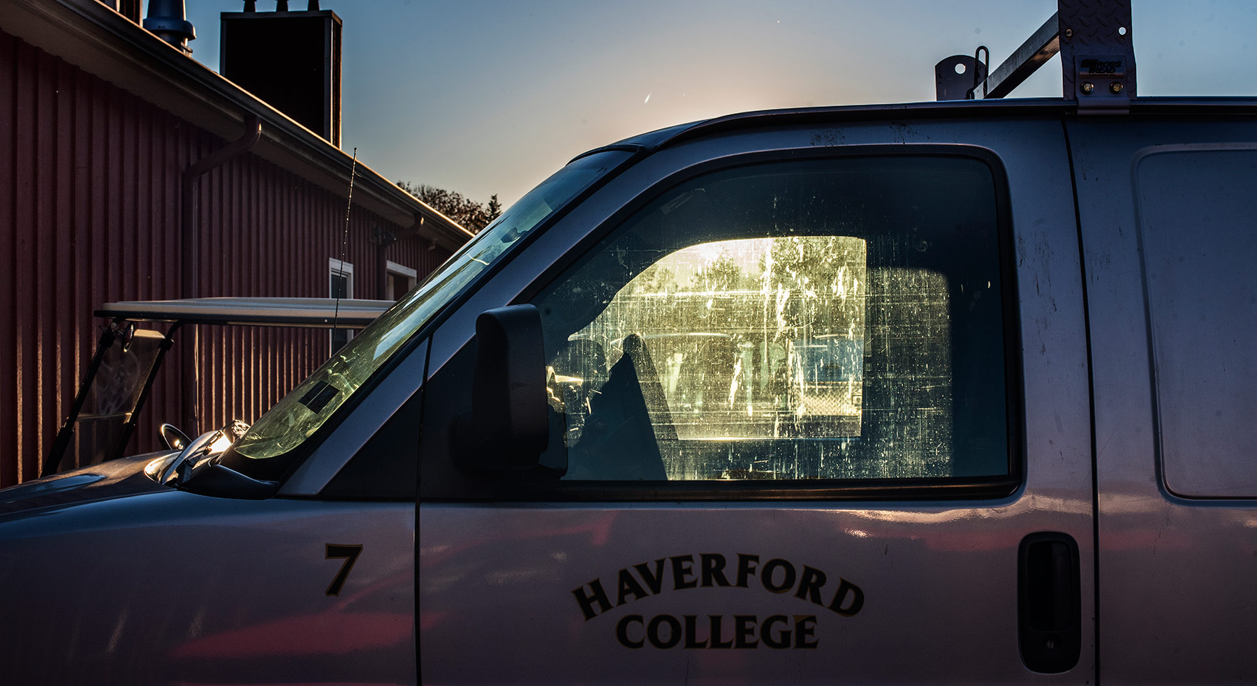 A photo of a Haverford College truck at sunset