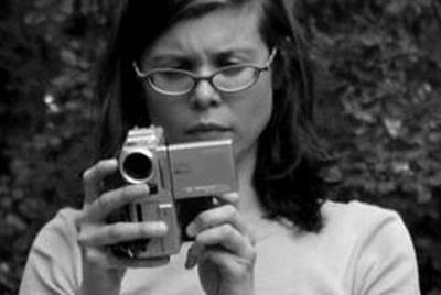 Hope Tucker holding a camera