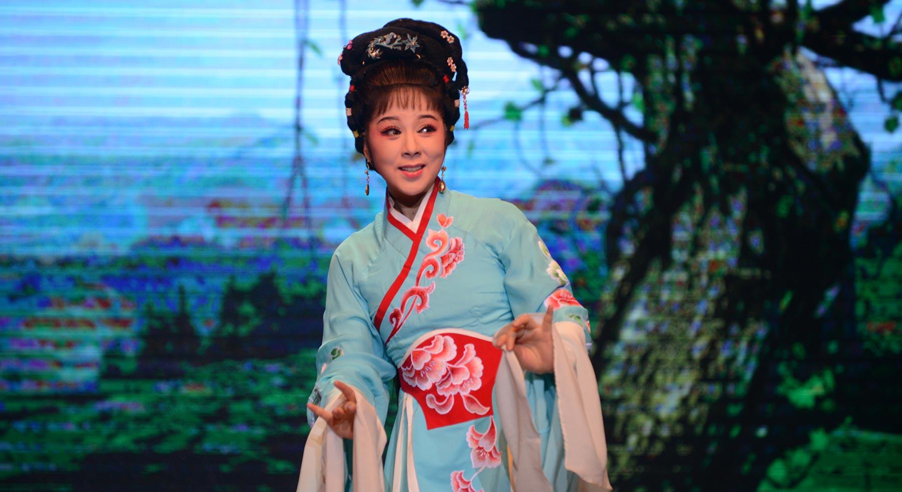 Huangmei Opera singer Xiaofang Chen on stage