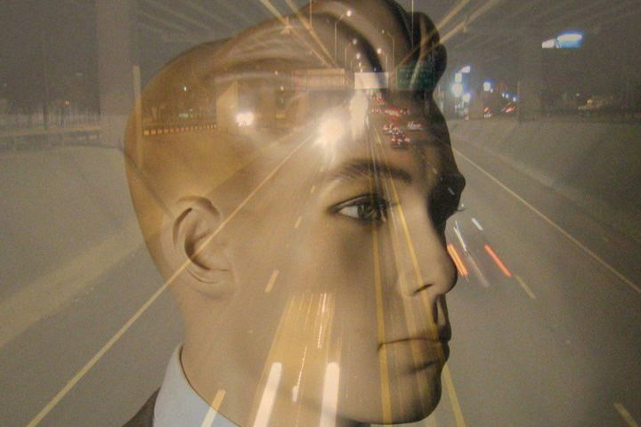 Image of a highway at night overlaid onto a mannequin's head