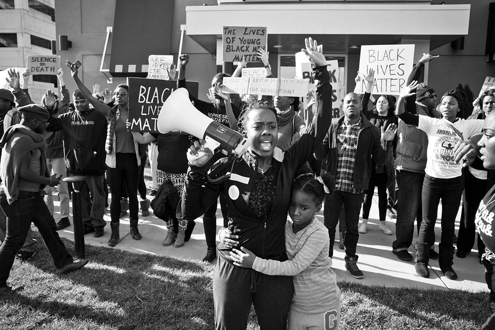 A young girl with a bullhorn at a Black Lives Matter event