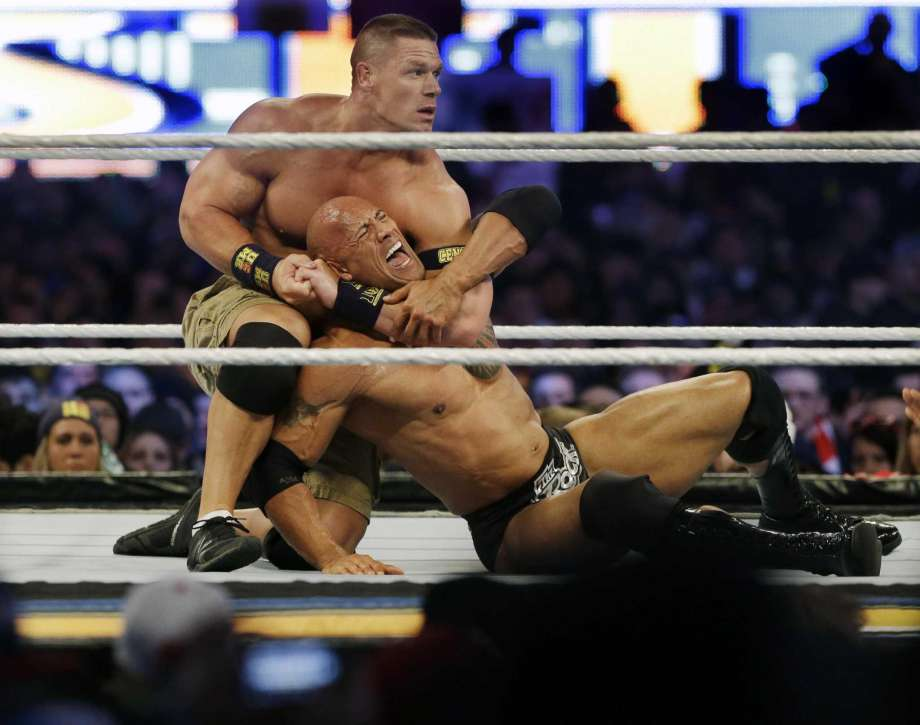 John Cena has The Rock in a choke hold