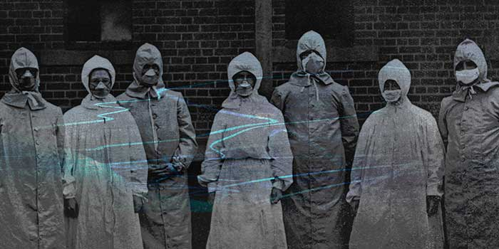 grainy, unsettling archival photo of people wearing protective suits during the Spanish flu pandemic