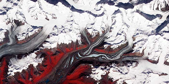 melting glaciers flow, tributaries joining to form rivers, evoking thoughts of infection spreading