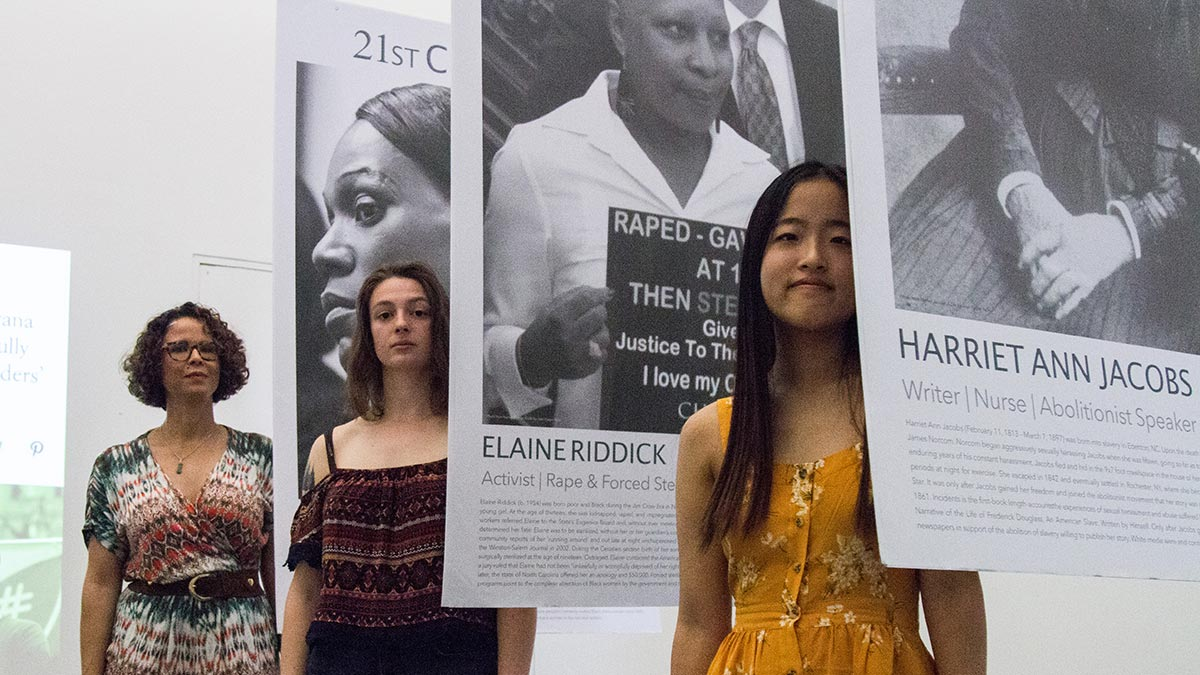 Anthropology students pose with their exhibit