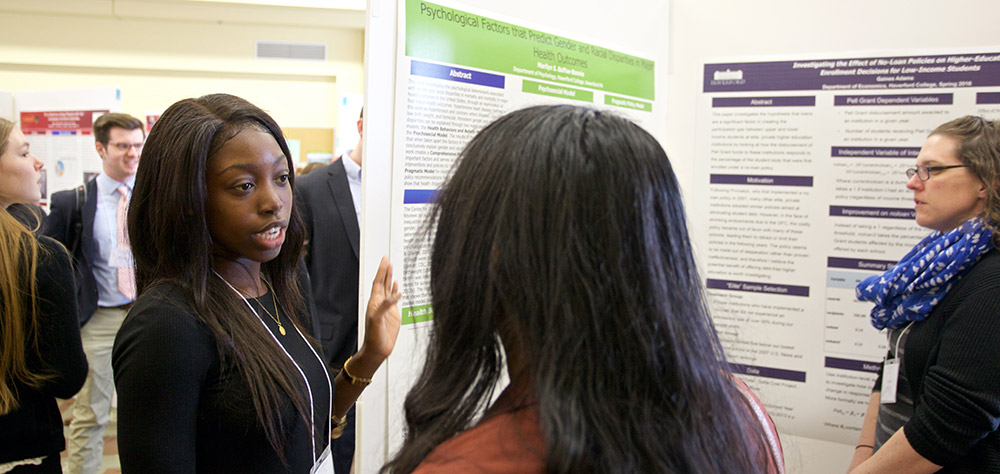 Marilyn Baffoe-Bonnie presenting her research poster