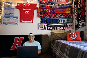 Sergio's room has colorful sports jerseys and pennants