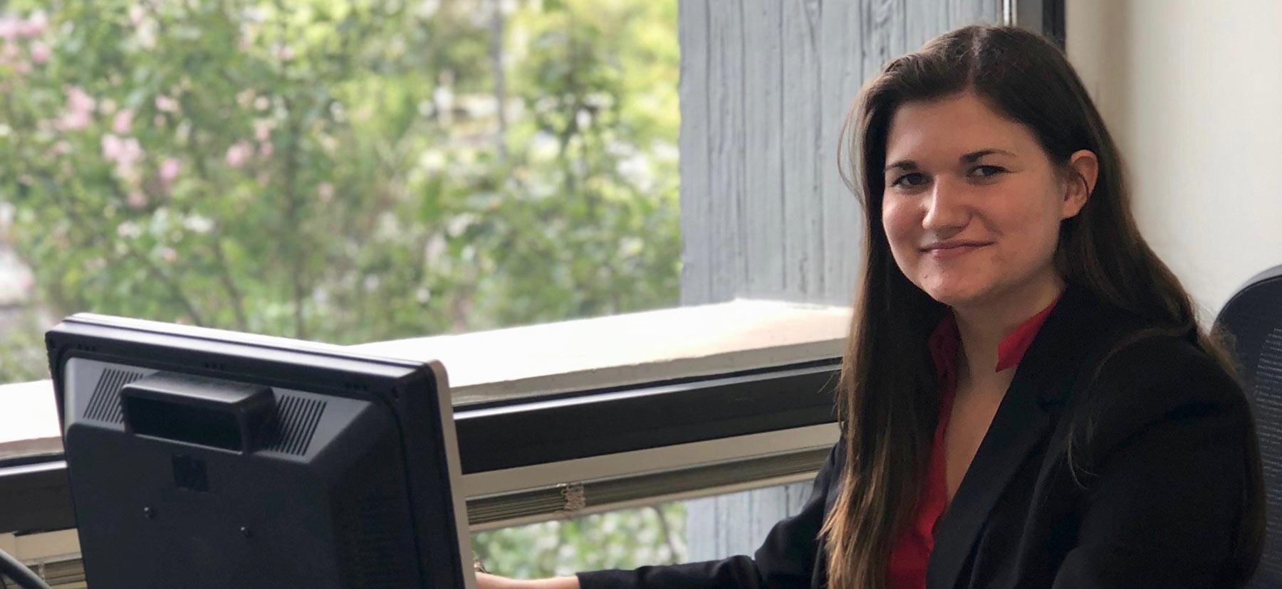 Chelsea Richardson '18 sits at her desk