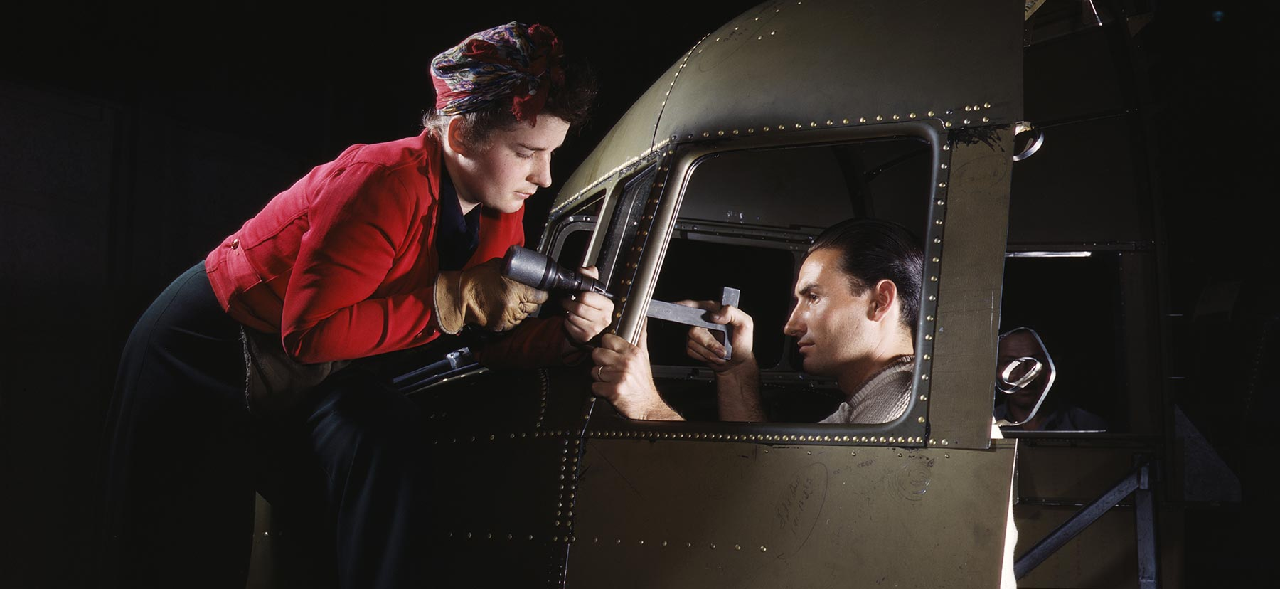 A man and woman riveting a cockpit