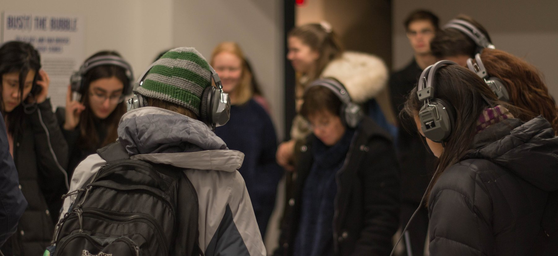 People listening to audio history recordings while wearing headphones