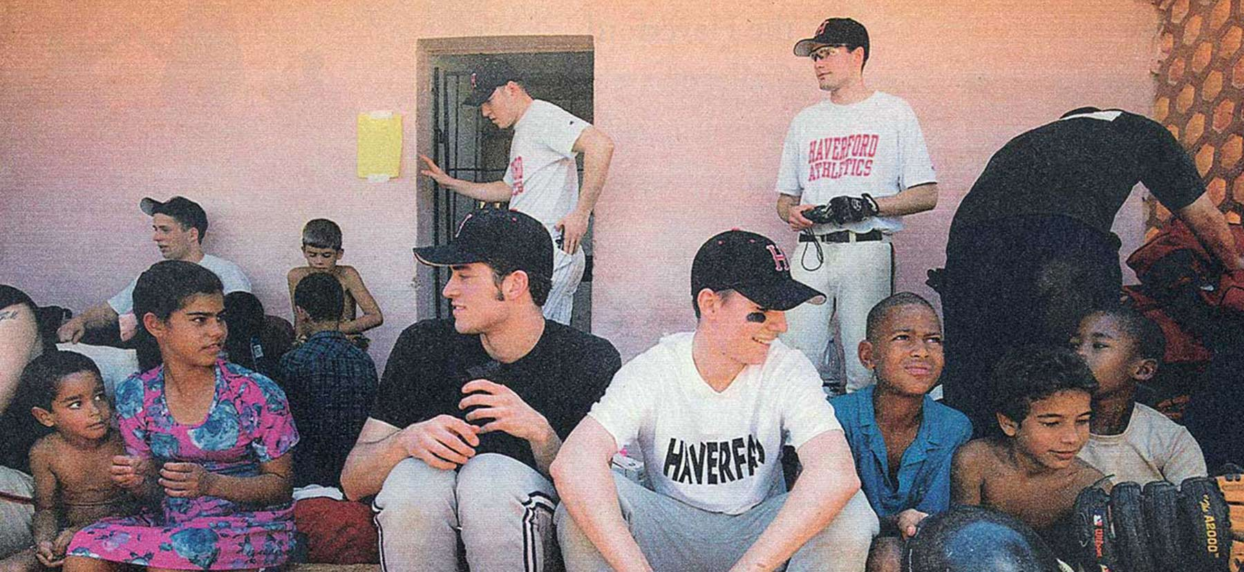 Members of the Haverford College baseball team with children in Cuba