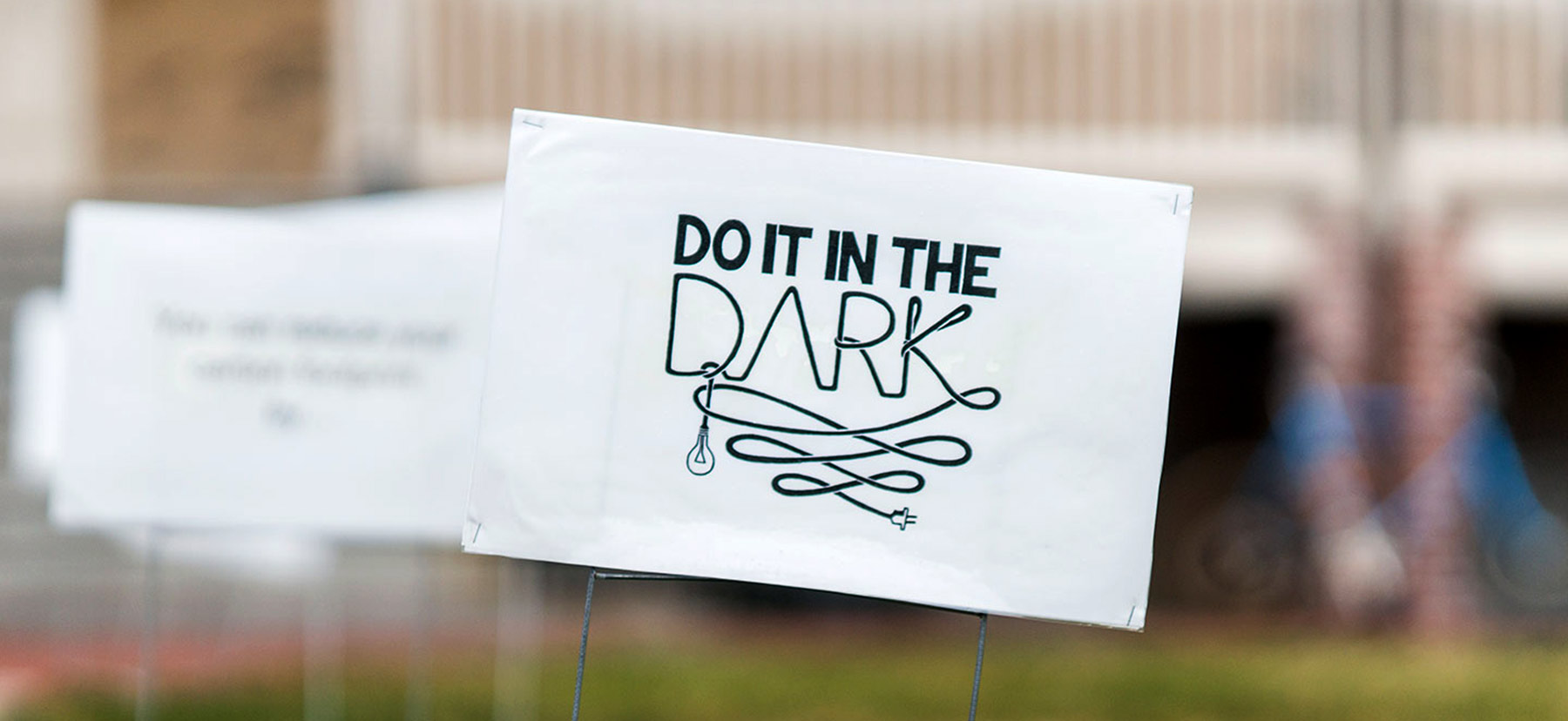 A Do it in the Dark sign