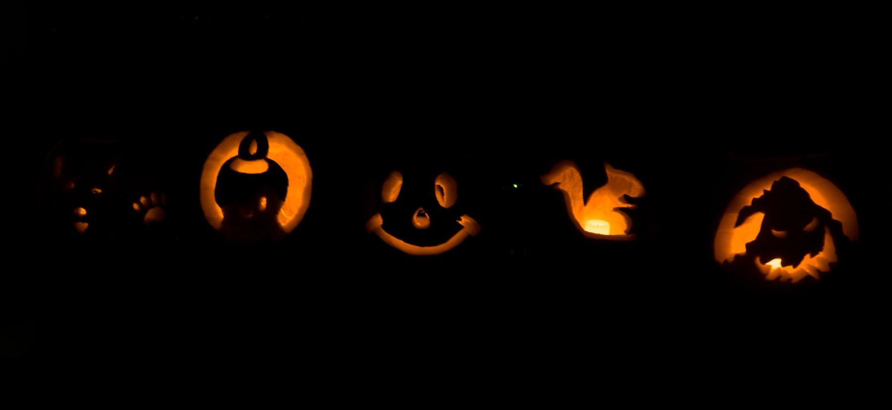 five silhouettes of jack-o-lanterns