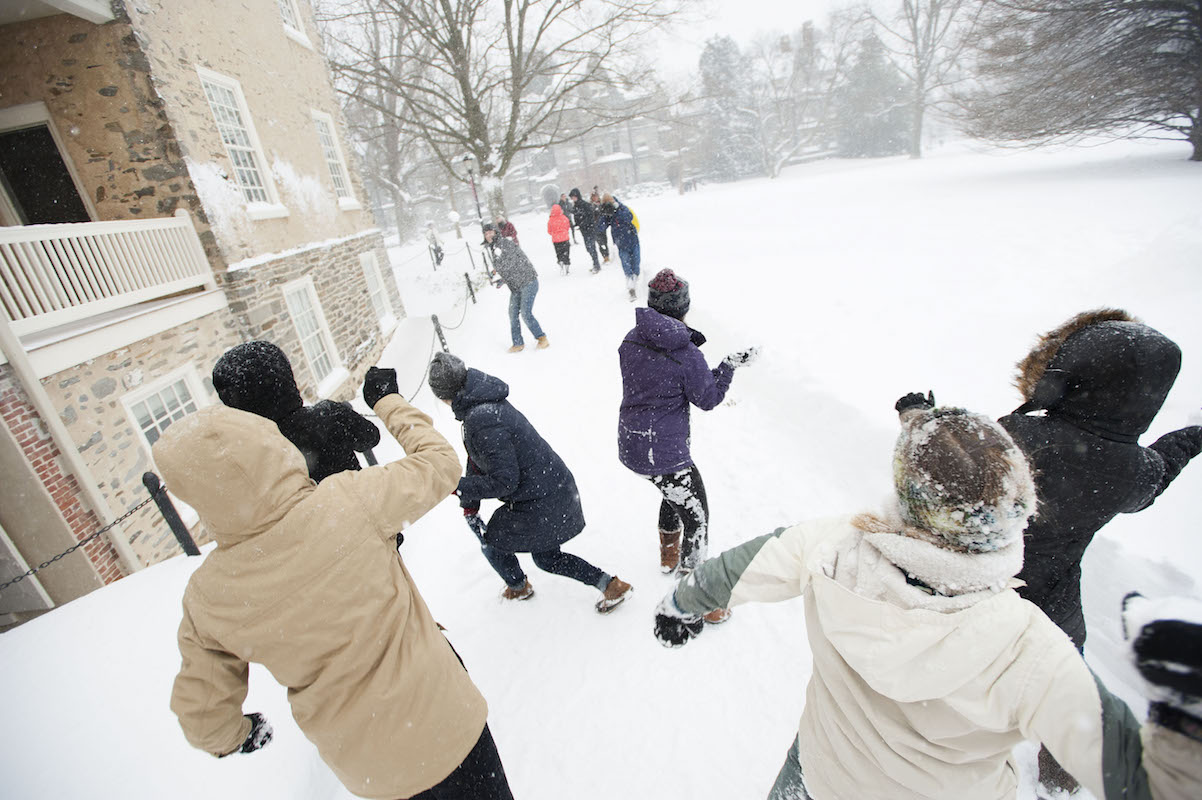 Students having a snowball fight on Founders Green