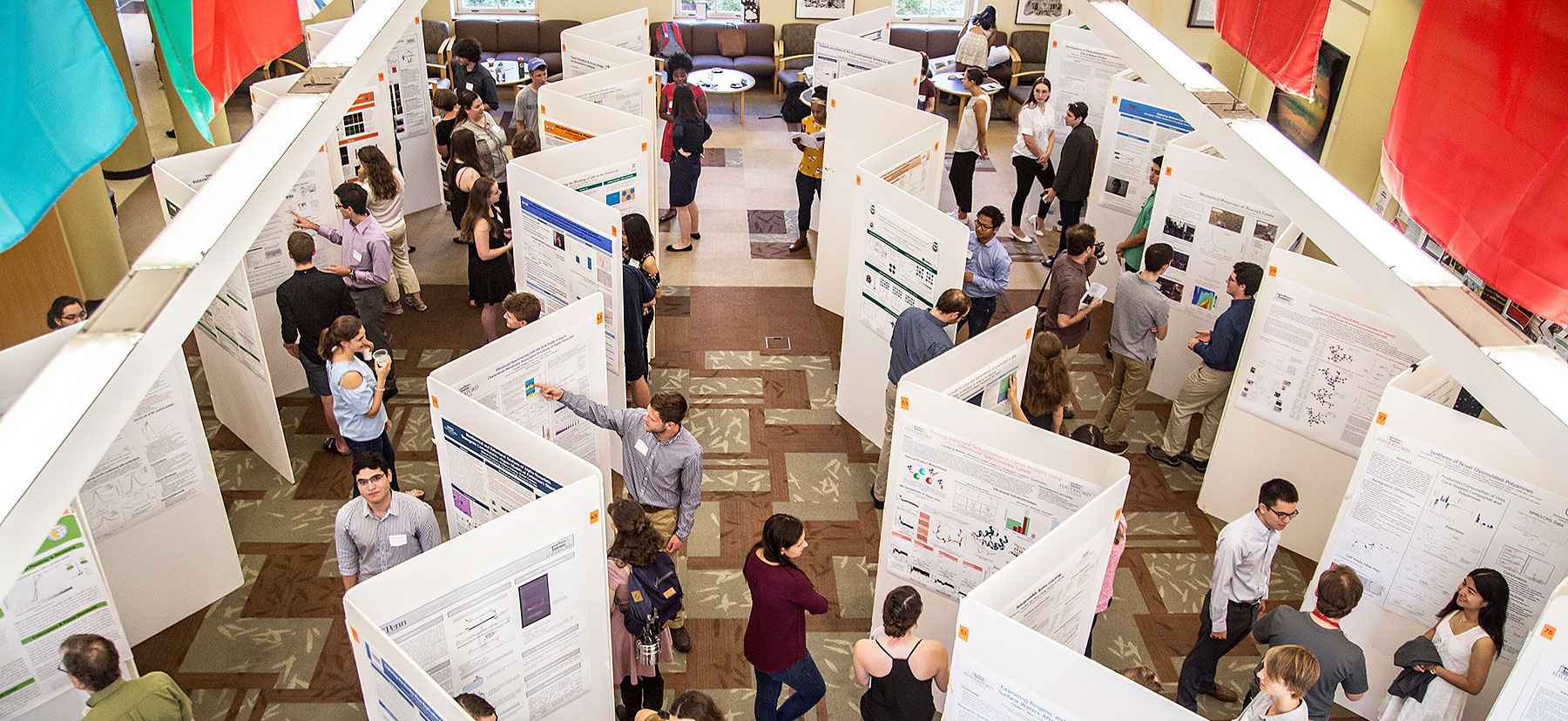Students giving poster presentations
