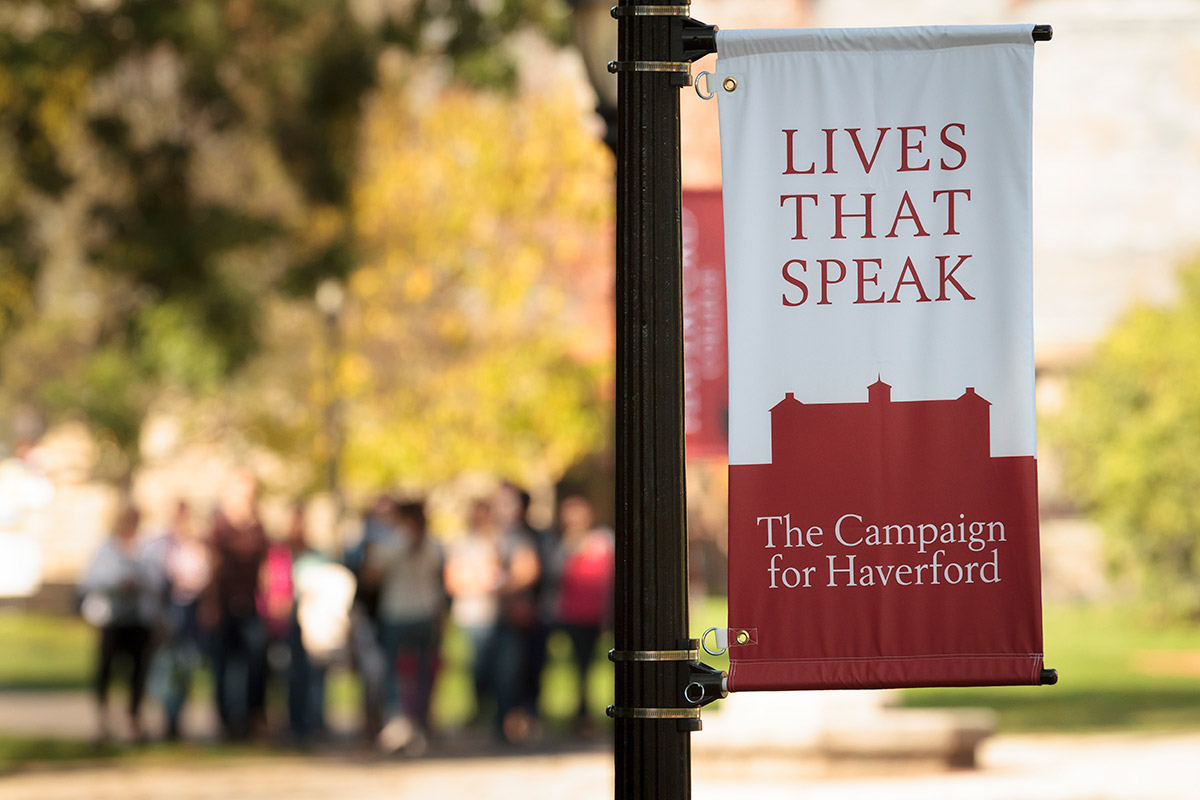 Lives That Speak banner with fall campus in background