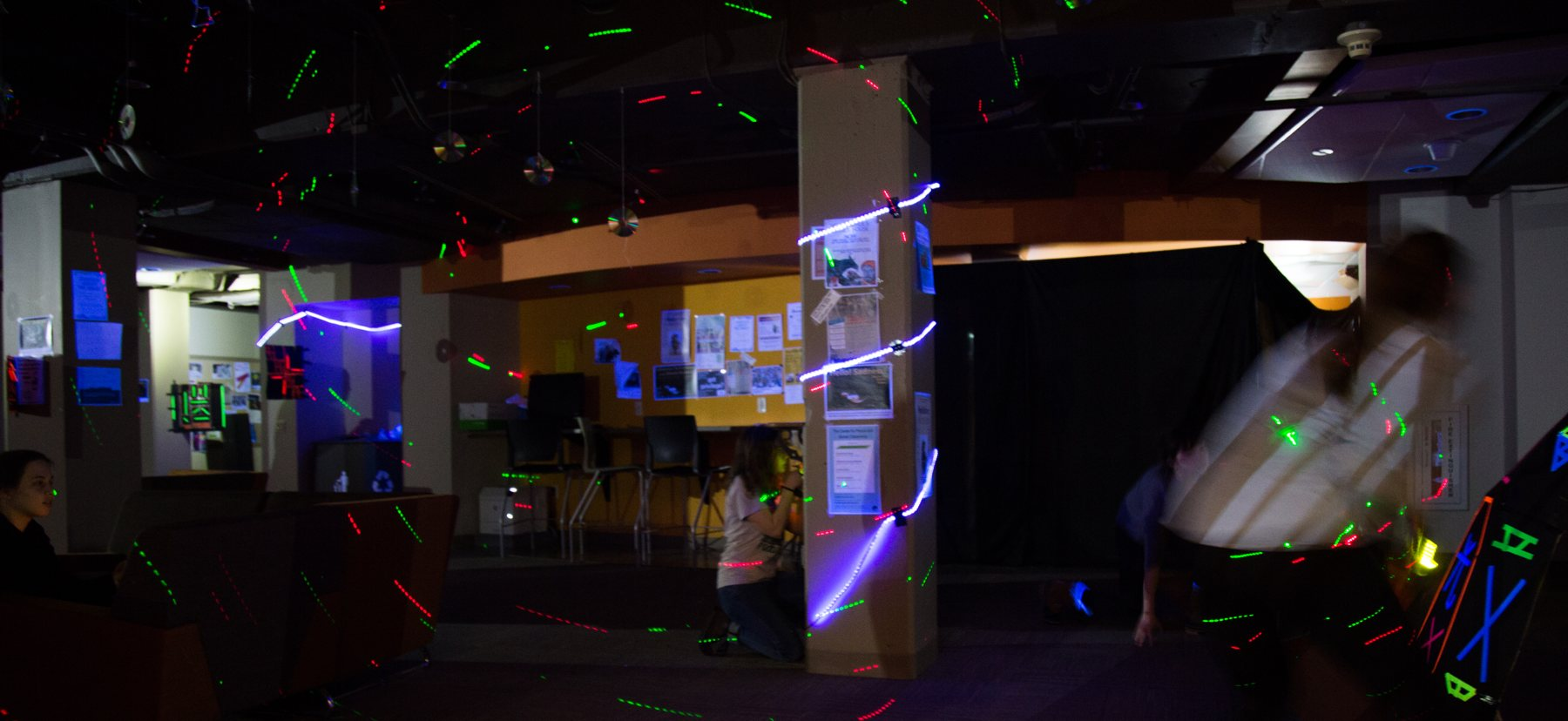 People playing laser tag in a basement