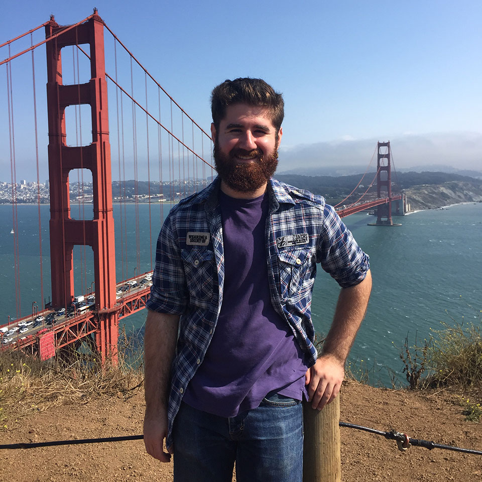 Ben Kaplow posing with the Golden Gate Bridge in the background