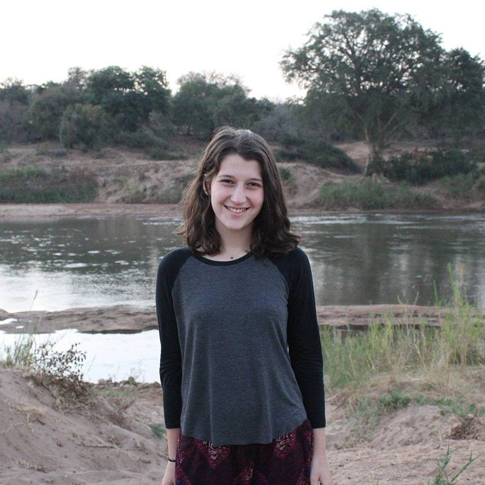 Bess Cohen standing alongside a river