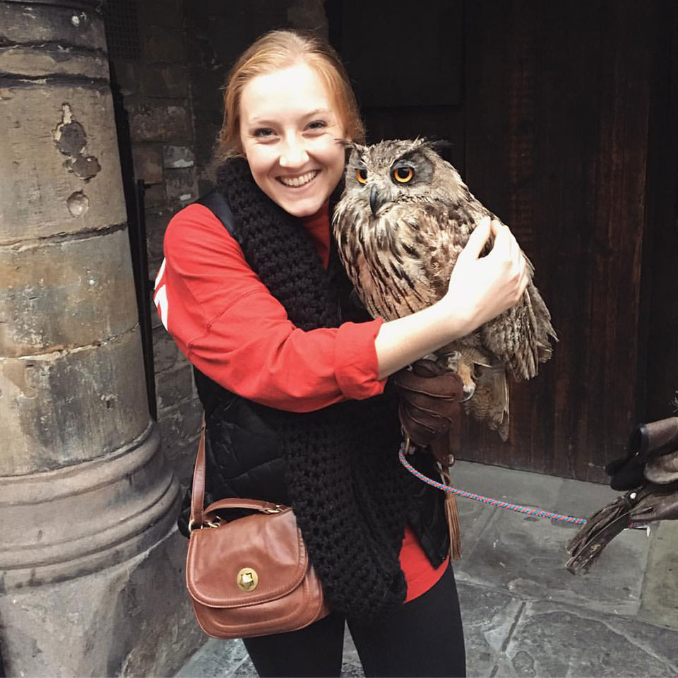 A happy Rachel Romens posing with an owl