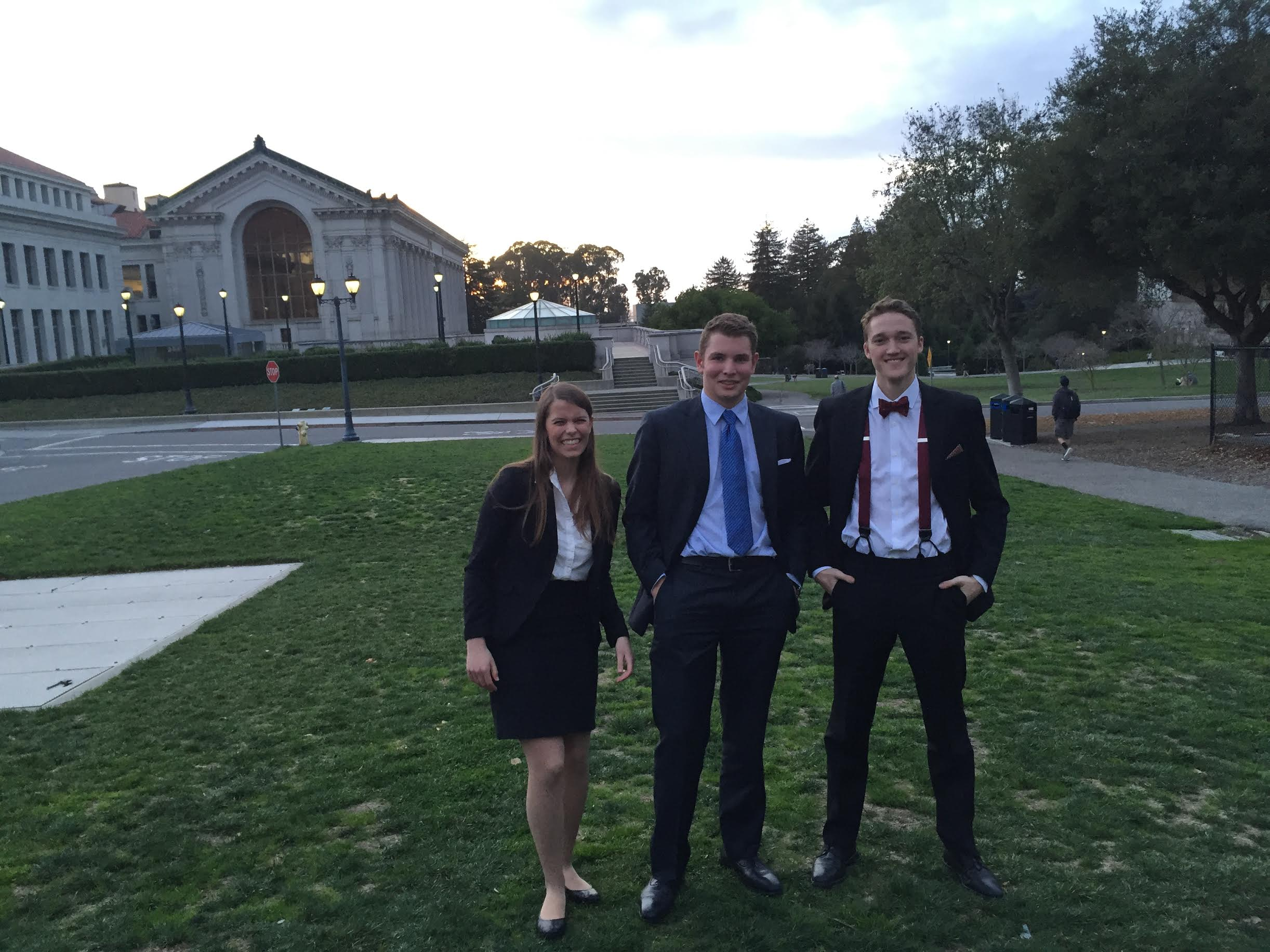 Three Mock Trial Group members posing together
