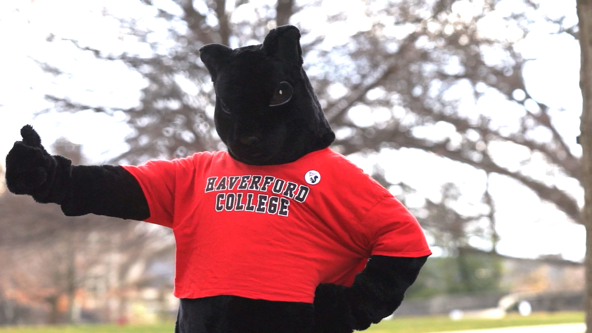 the black squirrel mascot giving a thumbs-up