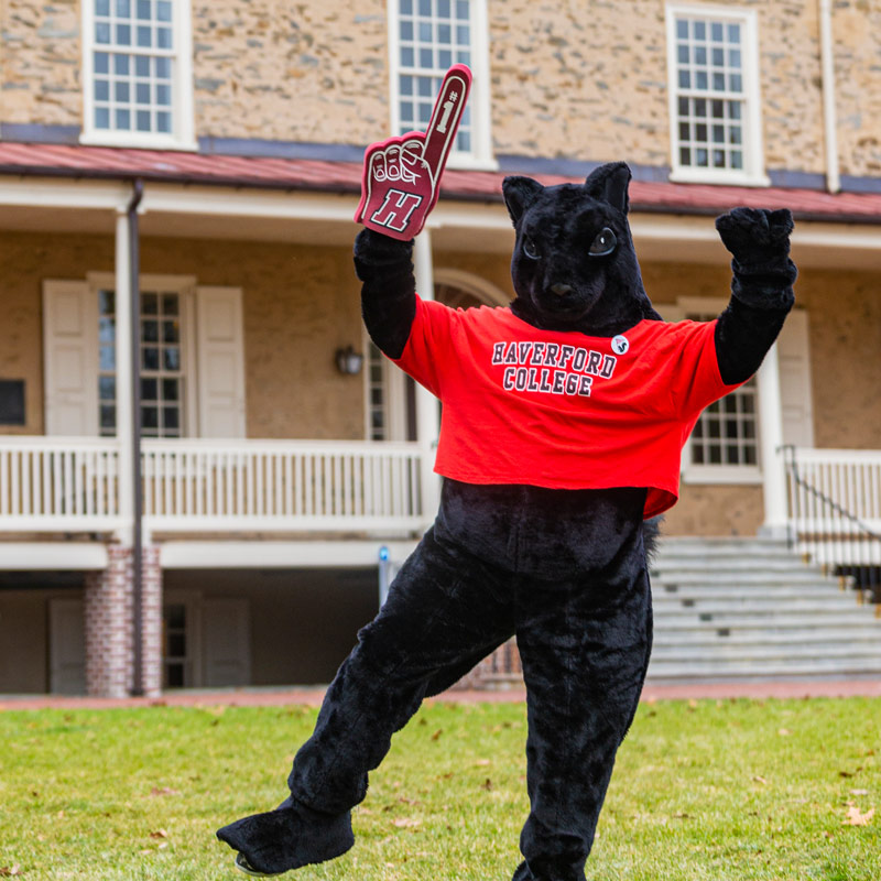 the black squirrel wearing a haverford tshirt and holding a number one foam finger