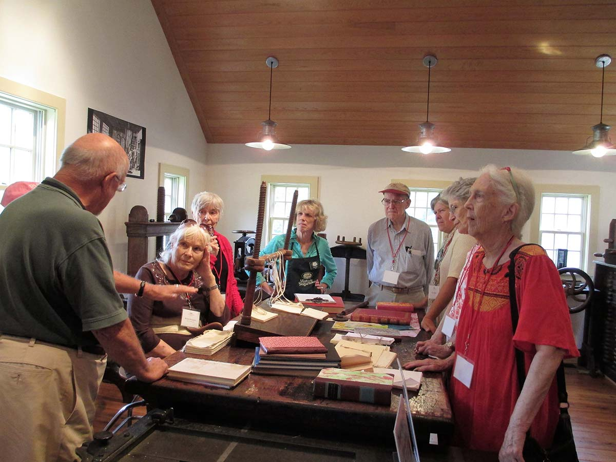 scarlet sages watch a demonstration on book binding