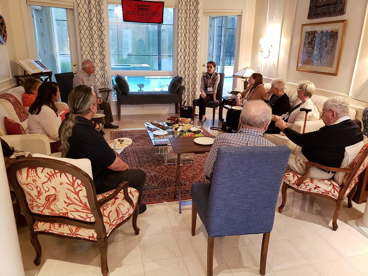 scarlet sages gathered together in a living room
