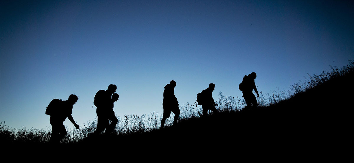 Silhouette of person hiking while migrating
