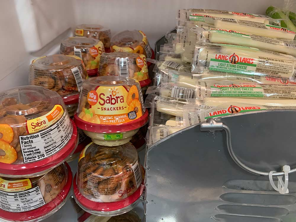 string cheese and snack packs in the fridge