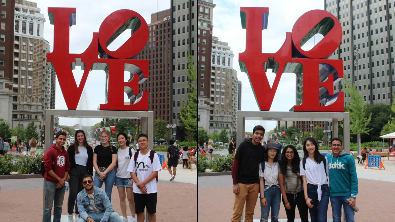 international students pose with the famous LOVE statue in philly