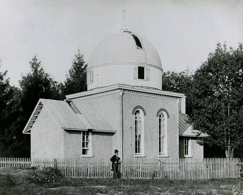A gentleman standing in front of Strawbridge Observatory