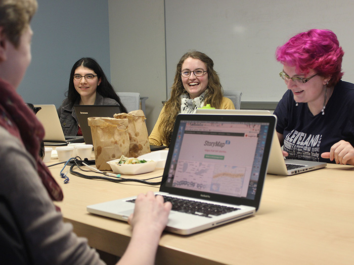 A group of Digital Scholarship Fellows working and laughing together