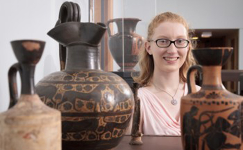 Jenn McKinley posing with Grecian vases