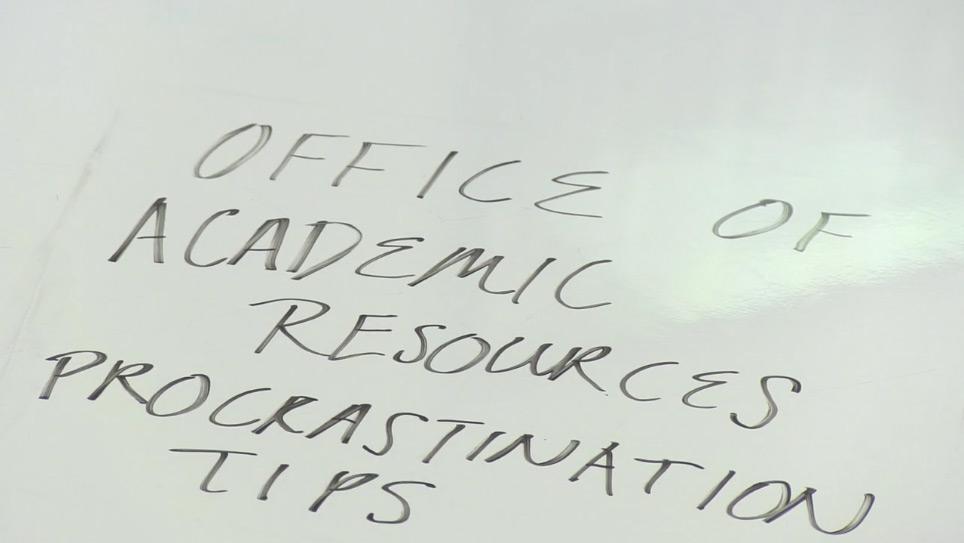 White board with OAR Procrastination Tips written on it