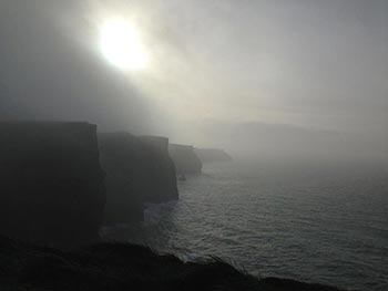 Cliffs almost entirely obscured by mist