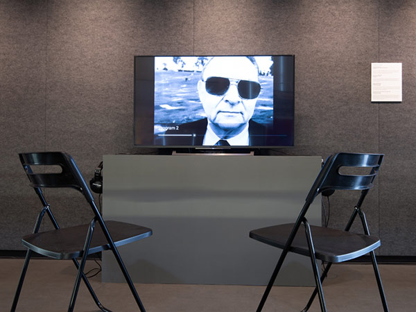 Two folding chairs placed in front of a viewing screen