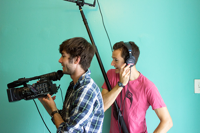 Students with film equipment shooting a documentary