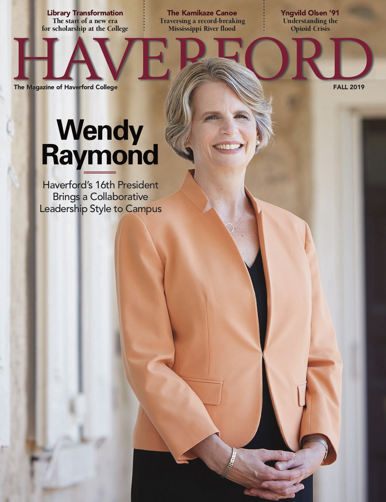 President Wendy Raymond stands on Founders hall porch