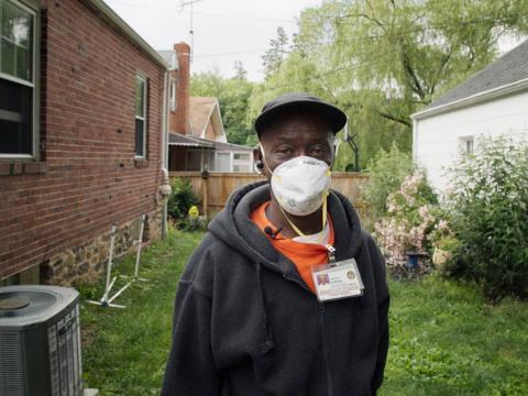 A man wearing a dust mask
