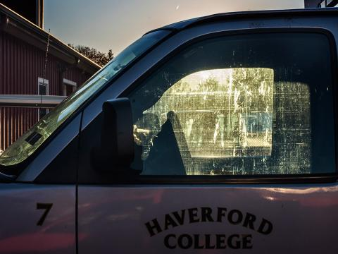 Photo of a Haverford College truck at sunset