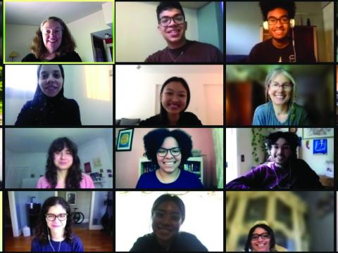 a Zoom screenshot of 20 smiling students and staff