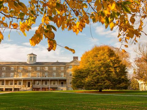 Founders Hall framed by fall foliage