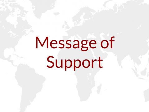 Message of Support written atop a world map