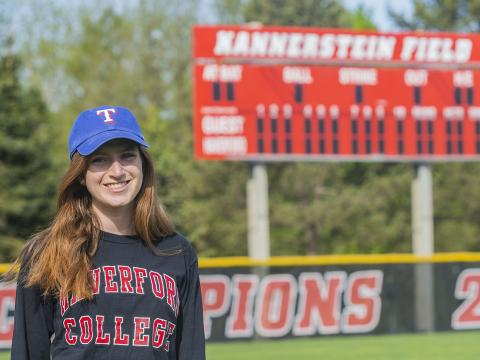 Charlotte Eisenberg on Kannerstein Field in her Texas Rangers hat