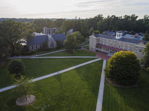An aerial view of Founders Green with paths cutting through the grass to Founders Hall